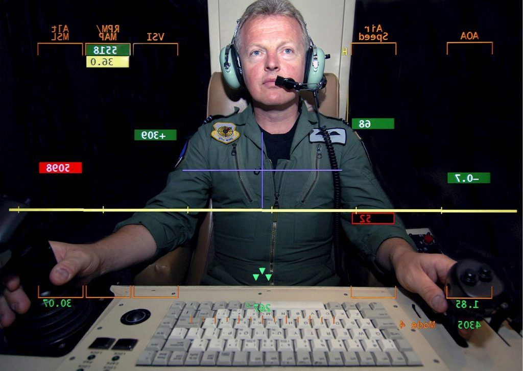 A Flight Lieutenant of 1115 Flight, shown at the controls of the Unmanned Aerial Vehicle called Predator.