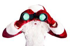 santa-claus-binoculars-over-white-background-62490957