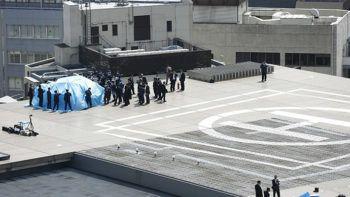 La polizia giapponese transenna l'area dell'atterraggio del drone