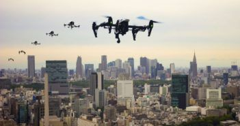 48063974 - flying through the town of drones tokyo japan image