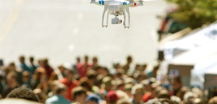 Flying Drone Hovers Over Crowd At Fair